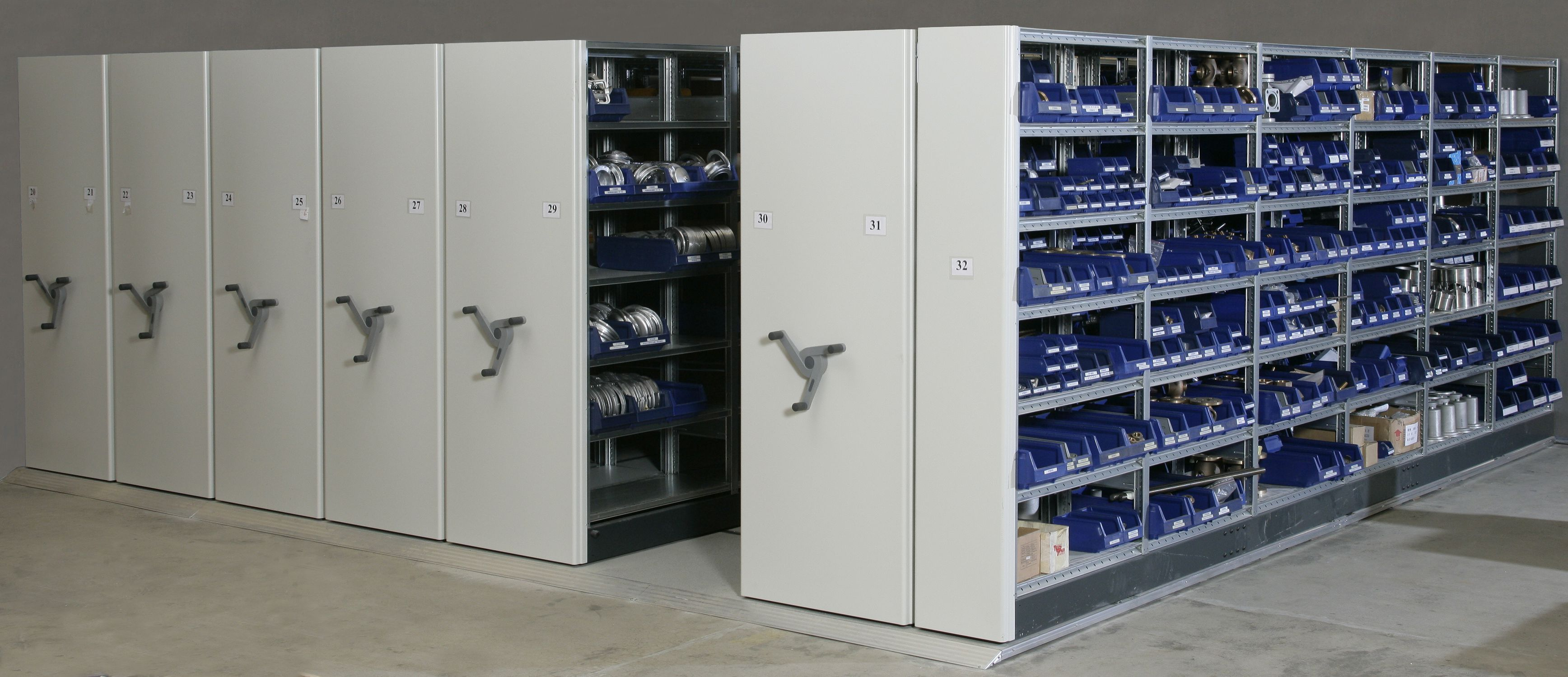Storage warehouse shelving / for medium loads / compact / mobile ...