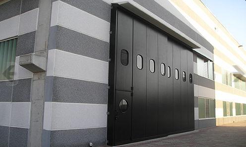 Folding door / metal / industrial / exterior - KOPRON SPA