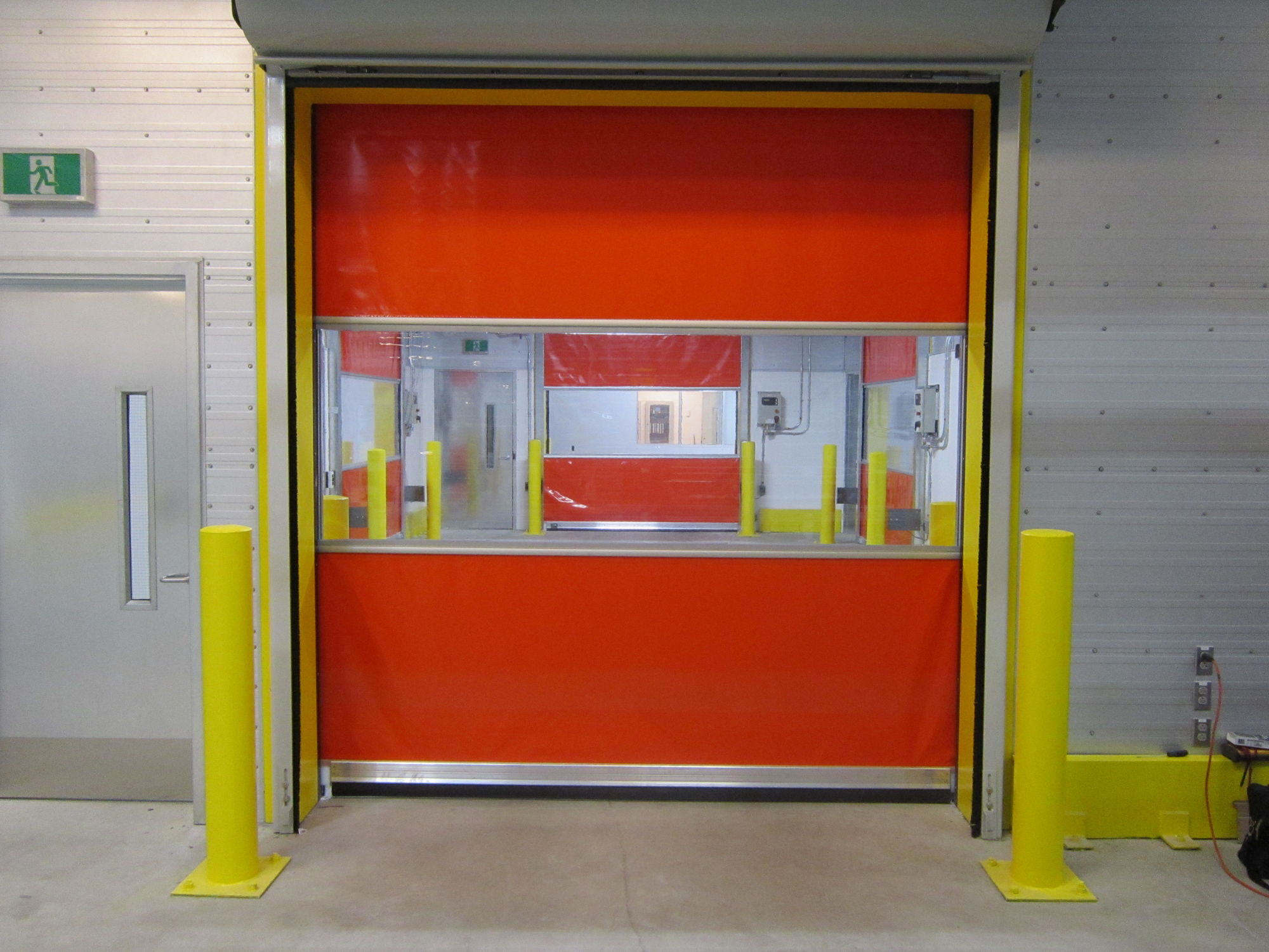 intellicore series doors energy polyurethane mt with airport commercial baker door overhead garage steel industrial spokane