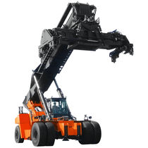 Pneumatic stacker truck / loading / unloading / for containers