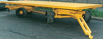 2-axle trailer / for industrial materials / flatbed / double swiveling axle