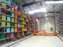 Vertical automatic storage system / for long products / with stacker crane