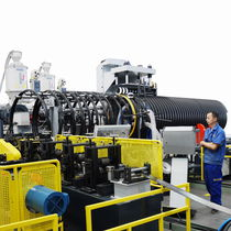Corrugated pipe extrusion line / for tubes / for steel-plastic composites / for corrugated pipes with integrated tube