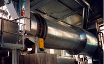 Revolving dryer / with cleaning system