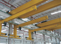 Wall-mounted wall traveling jib crane