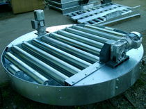 Motor-driven turntable / for conveyors / rotating