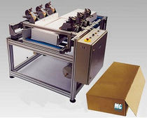Automatic stapling machine / for cardboard boxes