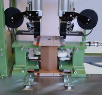 Cardboard box stapling machine