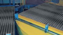Conveyor rotating unit
