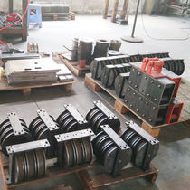 Automatic strapping device and tensioner / for metal straps / for plastic straps / with seal