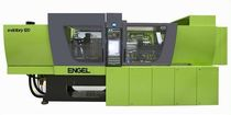 Horizontal injection molding machine / servo-electric / tie-bar-less