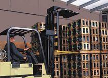 Load stabilizer / for forklift trucks