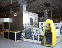 Robotic deburring cell / for machine tools