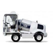 Self-loading concrete mixer