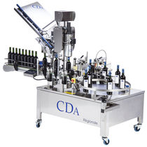Automatic labeler / for self-adhesive labels / for the wine industry / with capsuling system