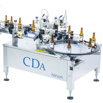 Automatic labeler / side / top / for self-adhesive labels