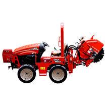 Rockwheel trencher / tractor-mounted