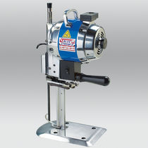 Manually-controlled cutting machine / for fabrics / straight-knife