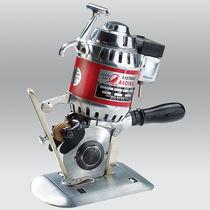 Rotary blade cutting machine / for fabrics / manual / portable