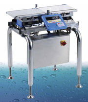 Packaging machine checkweigher