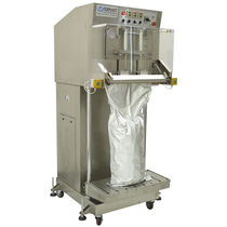 Semi-automatic packaging machine / vacuum / for the food industry / with modified atmosphere packaging