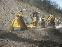 Rockwheel trencher / rubber-tired