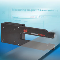 Laser strip thickness measuring device
