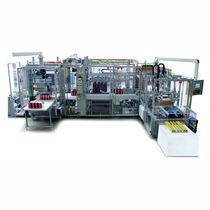 Wrap-around cartoner-sleeve wrapping machine / automatic