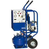 Refrigerant gas recovery unit