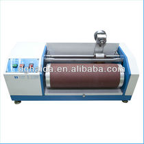 Abrasion and wear testing machine / for safety belts / for automobiles