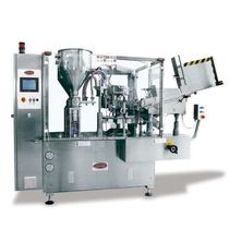 Automatic filler and sealer / rotary / for pipe ends