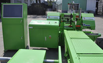 Band saw / with cooling system / with roller conveyor / precision