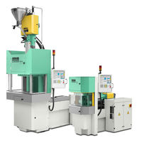 Vertical injection molding machine / servo-electric / rotating table