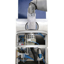 Automatic spray nozzle cleaning system