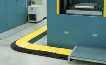 Floor-mounted cable protector
