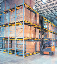 Flow storage shelving / push-back / for empty and full cartons / high-rise