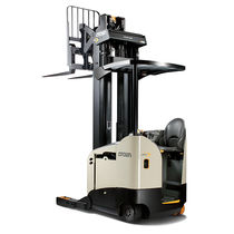 Electric reach truck / side-facing seated / narrow-aisle / handling