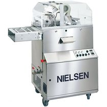 Enrobing and tempering machine