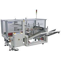Automatic carton erector / bottom sealer