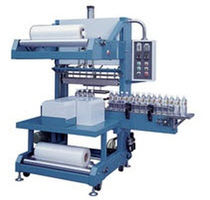automatic counting and sleeve wrapping machine (with heat shrink film) SBM 8040 CA American Packaging & Plant Equipment