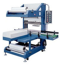 automatic sleeve wrapping machine (with heat shrink film) SBM 8040 American Packaging &amp; Plant Equipment