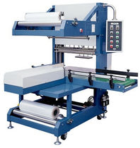 automatic sleeve wrapping machine (with heat shrink film) SBM 6030 American Packaging & Plant Equipment