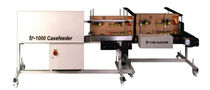 inkjet coding marking machine for cardboard boxes 20 - 45 p/min, 3300 x 1575 x 1150 mm | TR-1000 casefeeder Travtec Limited