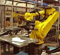 loading / unloading robotic cell for CNC machine  Wes-Tech