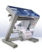slitter rewinder for plastic films AUTOSPLICER series UVA Packaging