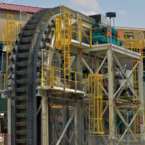 vertical reciprocating conveyor (VRC)  The Robbins Company