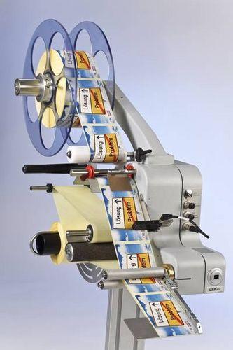 motorized dispenser / label / compact