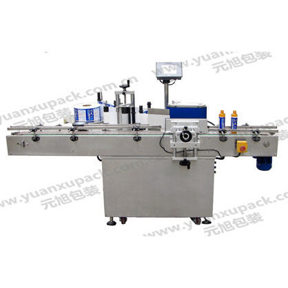 automatic labelling machine / for bottles / side