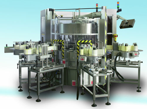 Top labeler / rotary / for self-adhesive labels / high-speed Opera Sacmi Labelling