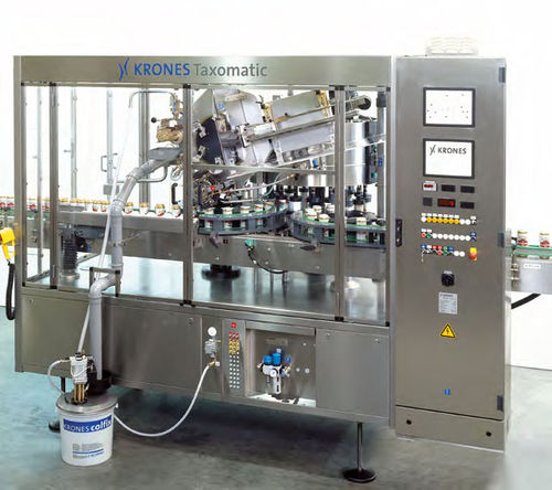 Automatic labeler / top / for bottles / rotary Taxomatic KRONES